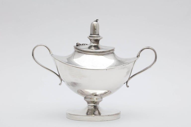 Edwardian, sterling silver, Aladdin's lamp-style table oil lamp or lighter, American, circa 1920s. Measures: 4 inches high (at highest point) x 5 inches across from handle to handle x 2 inches deep at deepest point. Weighs 3.930 troy ounces. Oval