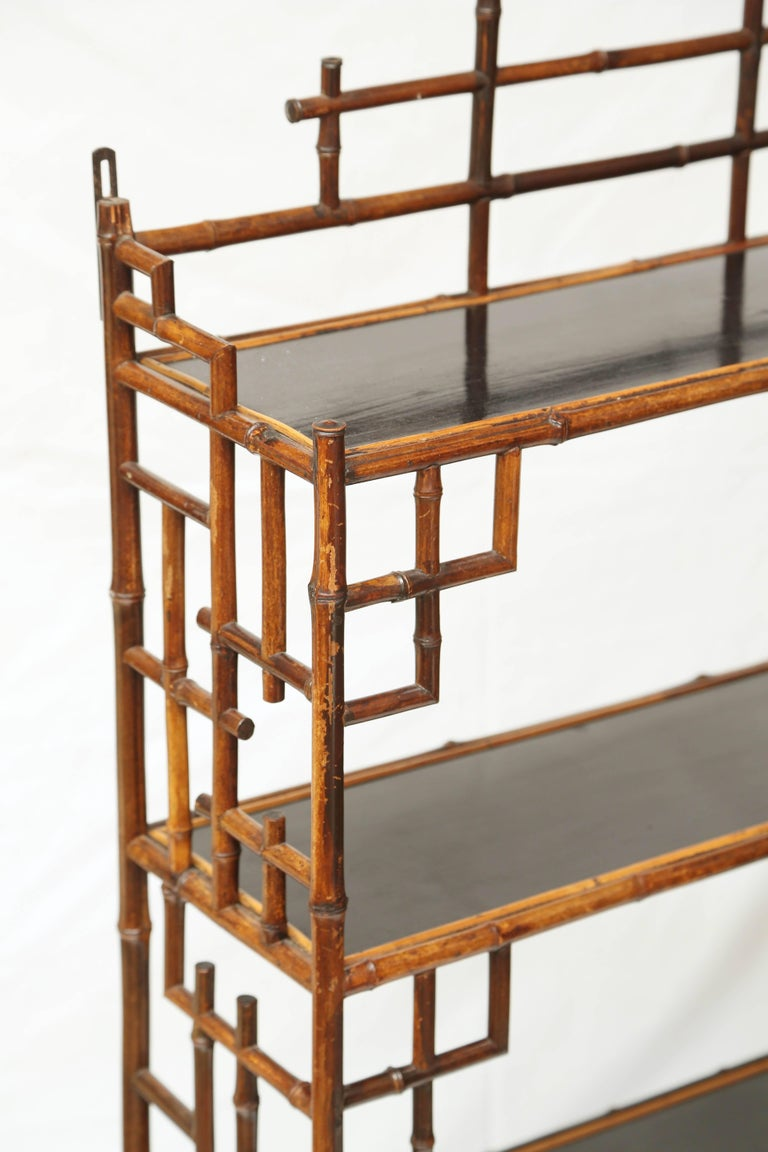 Beautiful hanging 19th century bamboo étagère with two drawers.