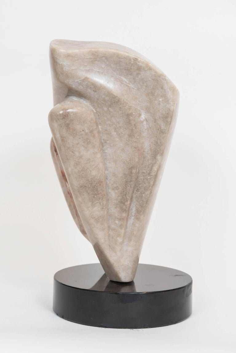 This great decorative abstract marble sculpture is mounted on a ebonized 8