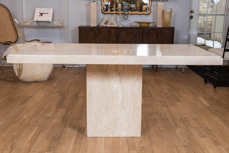 This handsome simple yet stylish vintage custom travertine limestone table is perfect as a breakfast table, desk or center hall piece. The double edged step-back top fits snuggly on a single pedestal and can be removed for transportation.