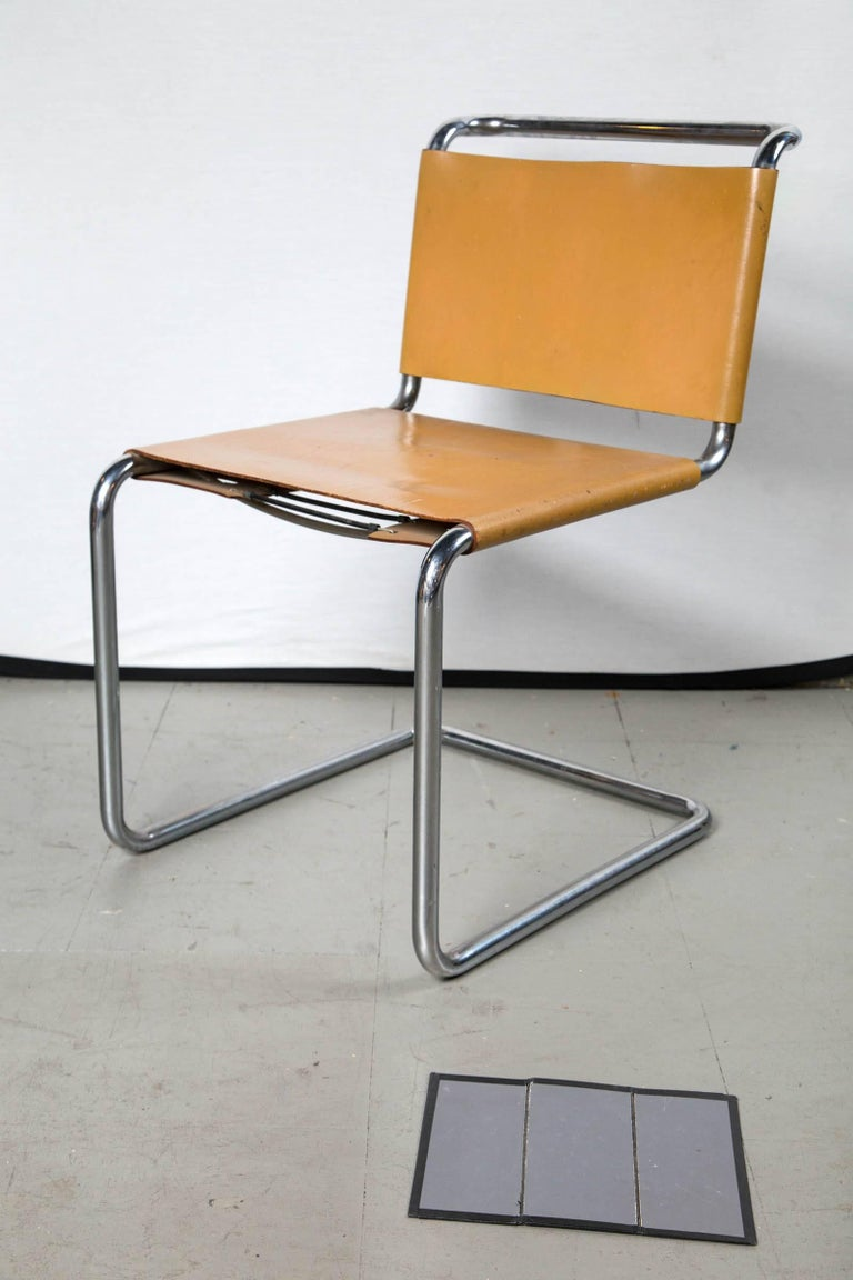 A rare set of four Marcel Breuer butterscotch cognac leather and chrome chairs. The leather now showing wear all around and feeling butter soft consistent with age. Nice and sturdy with a springy comfortable feel original laces tie back on each