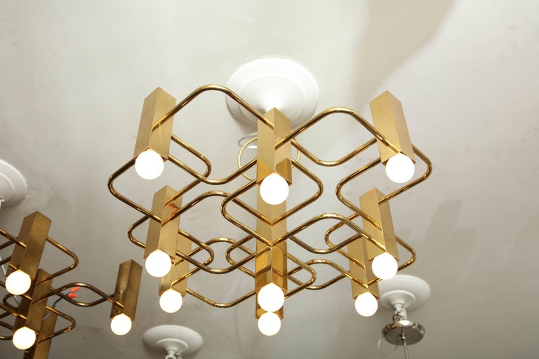 Nine-arm Sciolari chandelier pendant in brass.
