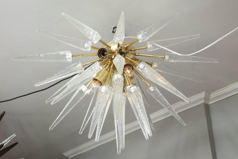 Murano clear spike half flush mount sputnik with polished brass finish.