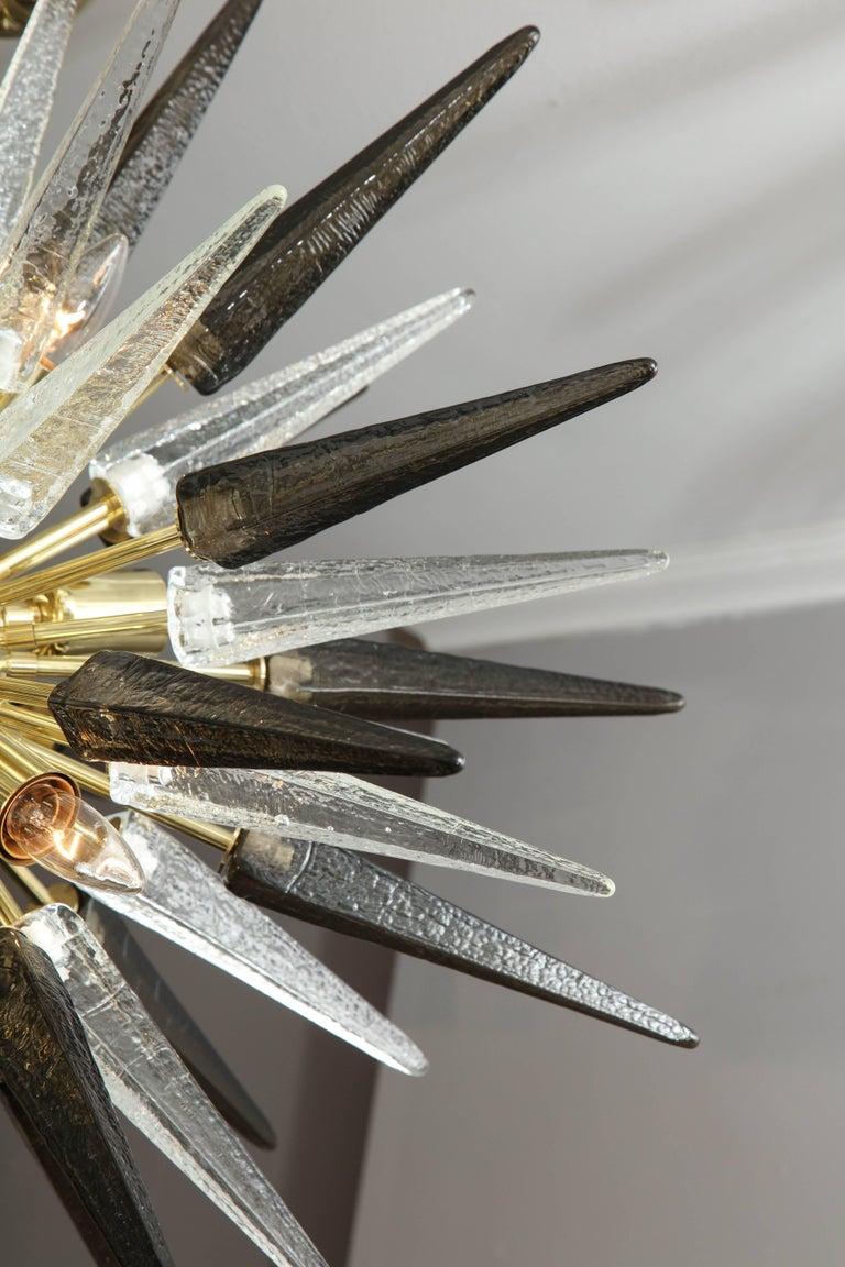 Murano smoke and clear glass spike Sputnik with polished brass finish.