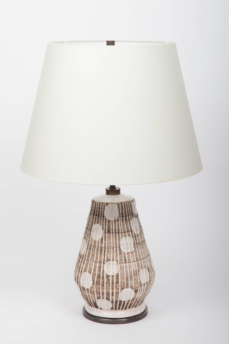 Ceramic table lamp in brown and white with graphic dots,  France 20th century.  Shade not included Newly rewired with black twisted silk cord and bronze finish on fittings.