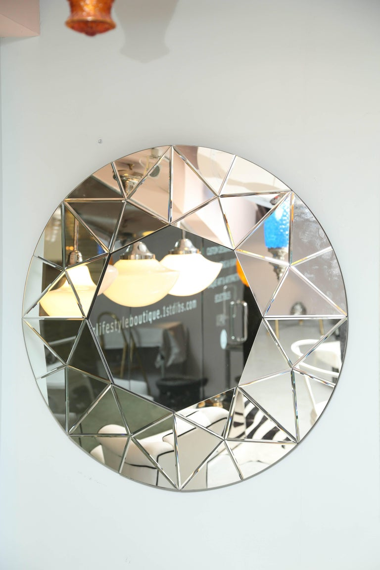 This mirror will add great elegance to either a contemporary or traditional room. Measures: 40 in.