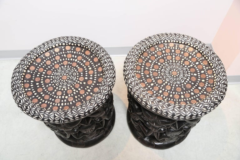 Contemporary Pair of African Side Tables Extensive Woodcarving Top Inlaid Coins, Cowry Shells For Sale
