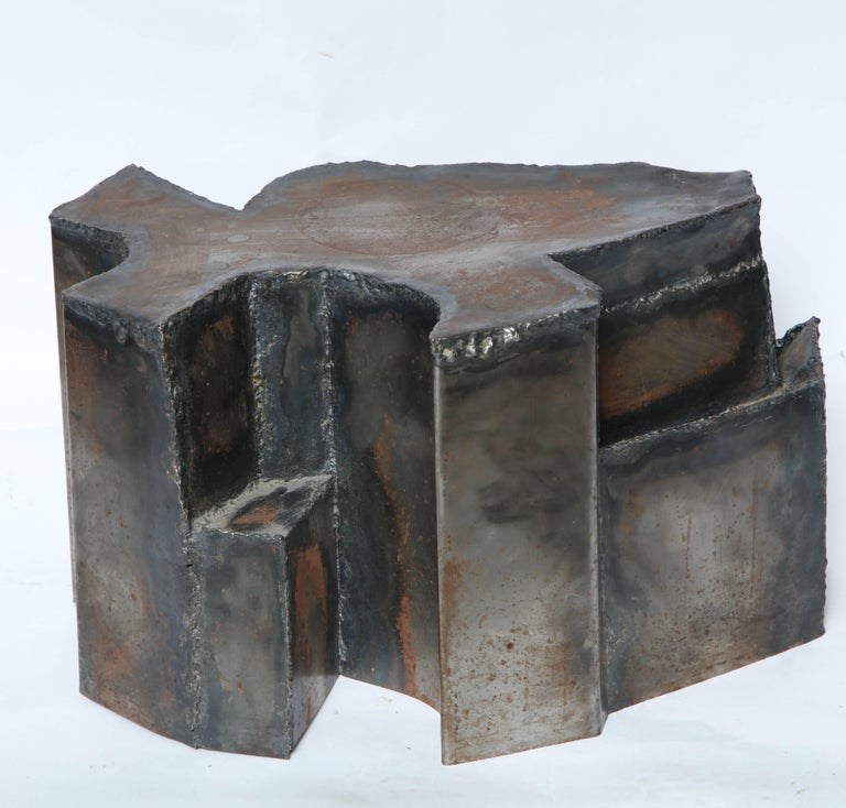 A Brutalist Mid-Century Modern sculptural handcrafted patinated metal end table.