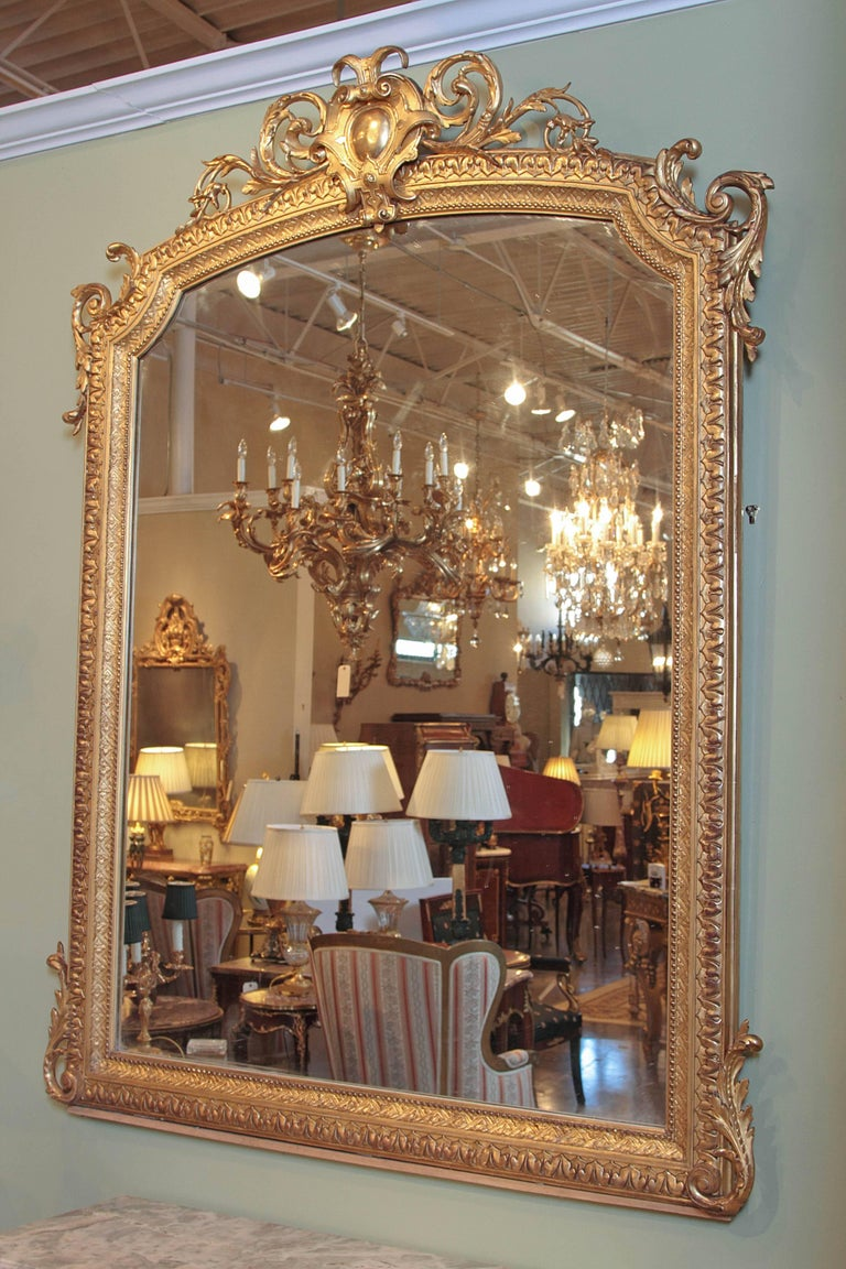 French large and finely carved 19th century Louis XV water gilt mirror.