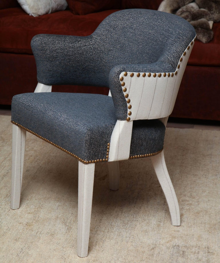 Pair of 1940s barrel back chairs clad in a taupe striped linen and upholstered in a blue woven chenille with nailhead trim.