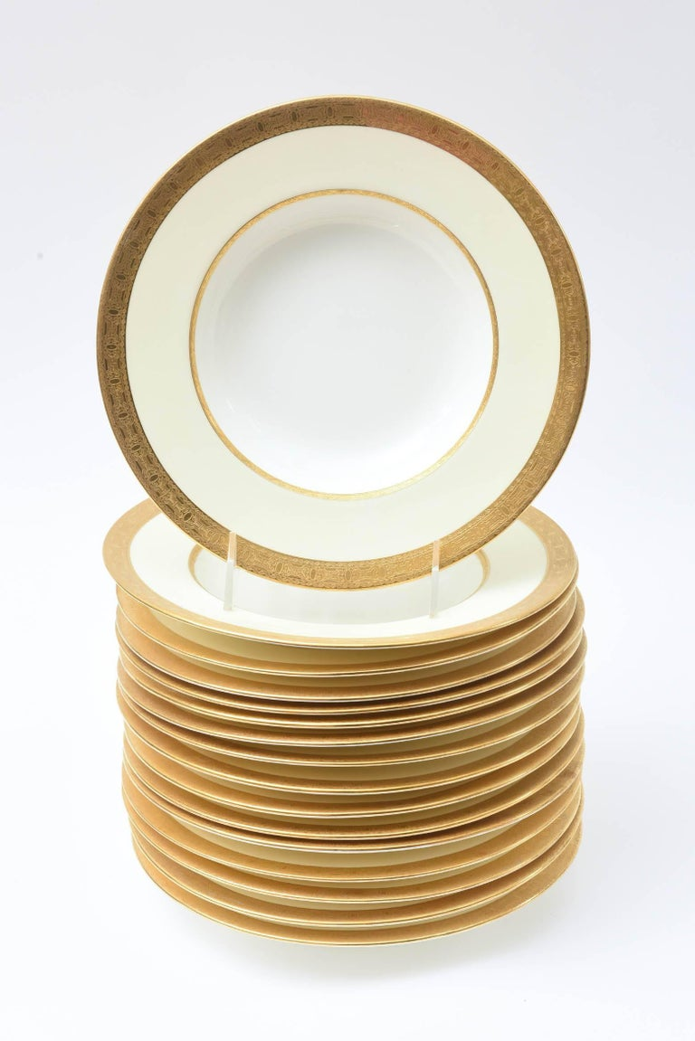 A pretty and Classic 24-karat gold etched banded rimmed soup bowl from Minton. A perfect pattern to mix and match in with all your fine porcelain tabletop. Our go to place piece for soup, pasta, first course or dessert with ice cream or sauces. You