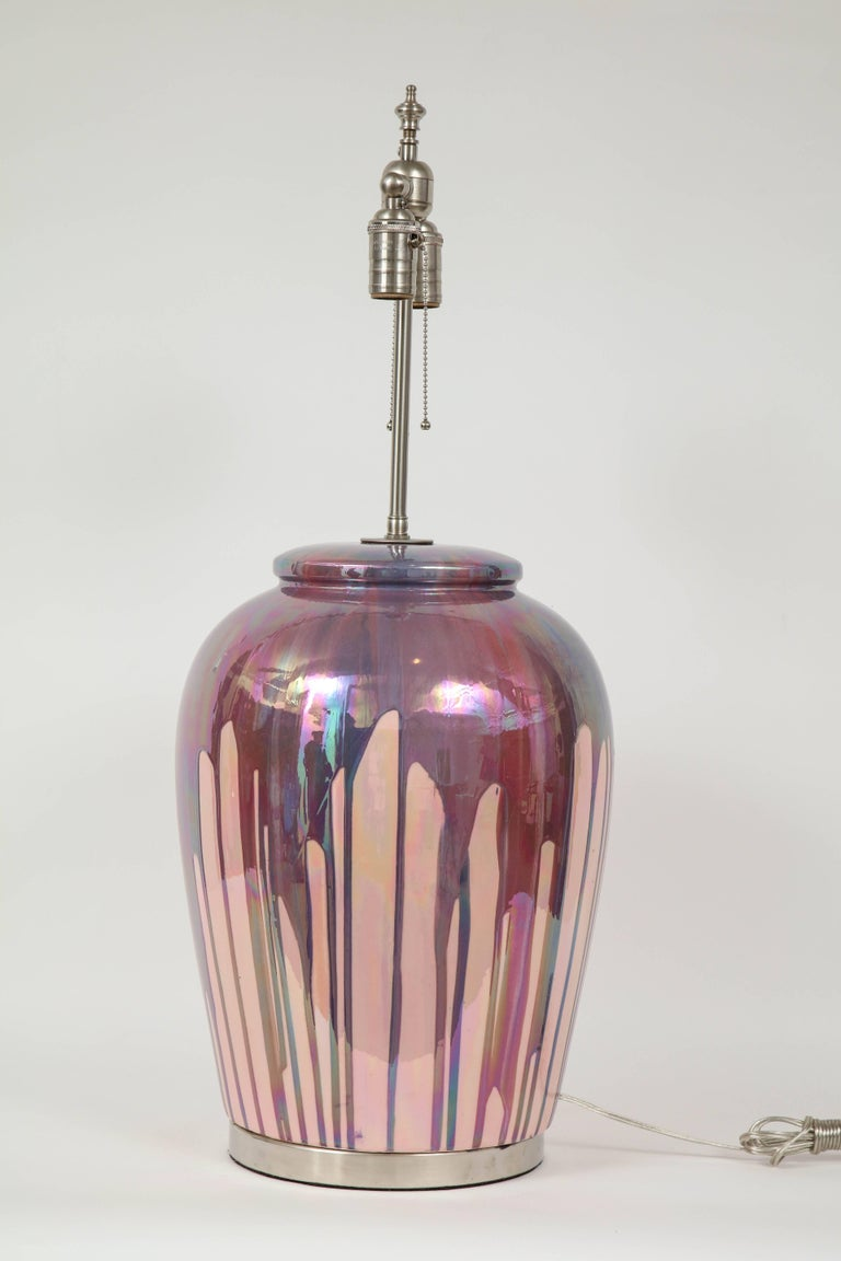 Large-scale mesmerizing midcentury Italian porcelain ceramic glazed lamps in a blush or rose color and iridescent purple or raspberry drip overglaze sitting on satin nickel bases. Rewired for use in the USA with satin nickel cluster sockets.