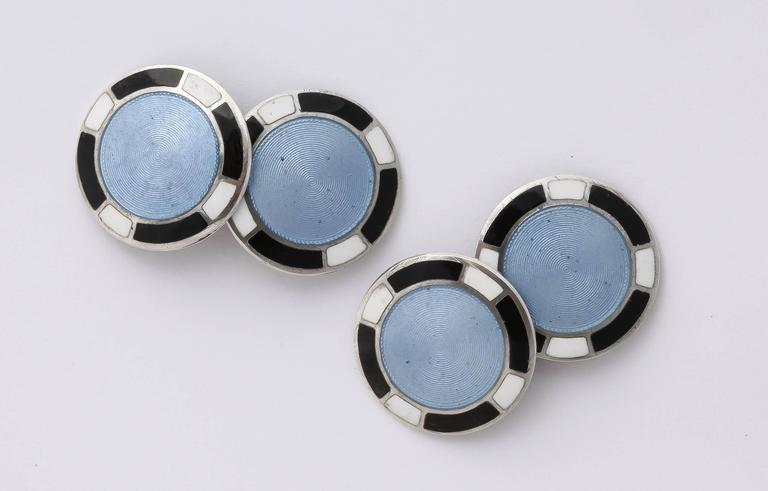 Circular with central medium blue circle surrounded by alternating black and white border. Impressed STERLING/ F & B.