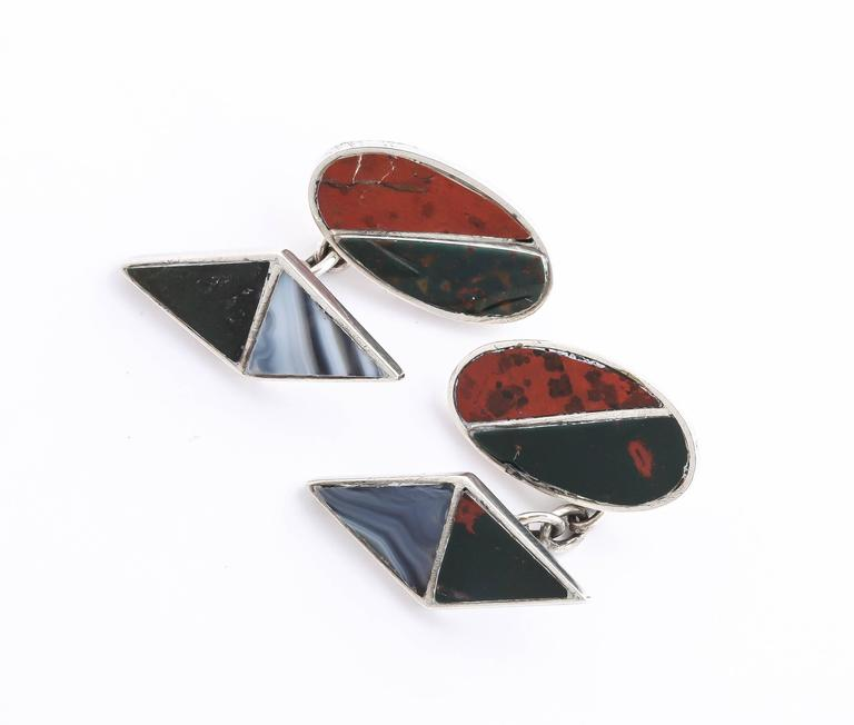One side is oval inset with Jasper and Bloodstone and the other is a diamond shape inset with Chalcedonyx and Black Onyx.  Impressed for 925 silver/ Birmingham/ 1929/ J C & S.