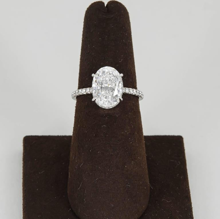 An incredible ring that can only be hand crafted by the worlds top jewelers.  3.01 GIA certified D color SI1 clarity Oval Diamond.  0.60 carats of matching round brilliant cut diamonds delicately set on the platinum band.  This ring is made