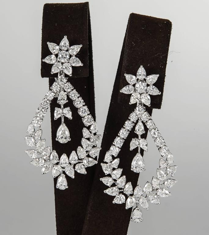 A unique pair of diamond drop earrings in a timeless design.