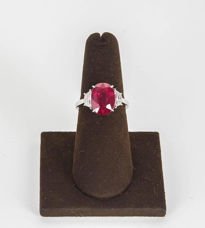 An elegant Ruby ring.   5.33 carat GIA certified Ruby set with special cut white side diamonds weighing 0.66 carats.   Set in platinum.