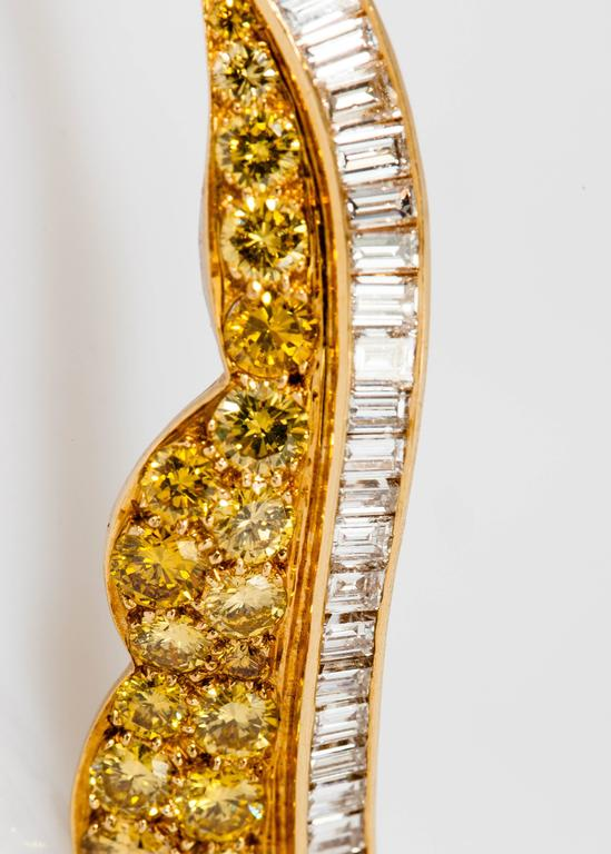 Designed as a stunning leaf of fancy-yellow diamond weighing approx.5.00 carats and baguette diamonds weighing approx. 3.50 carats, mounted in 18k yellow gold and platinum.