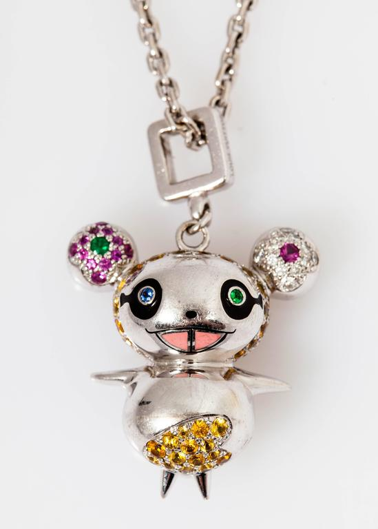 A masterpiece, very limited edition Takashi Murakami for Louis Vuitton Joaillerie Panda pendant set with 118 multi color sapphires weighing total approx. 3.68 cts, 14 emeralds weighing 0.18 cts and 12 round diamonds weighing approx. 0.16 cts,