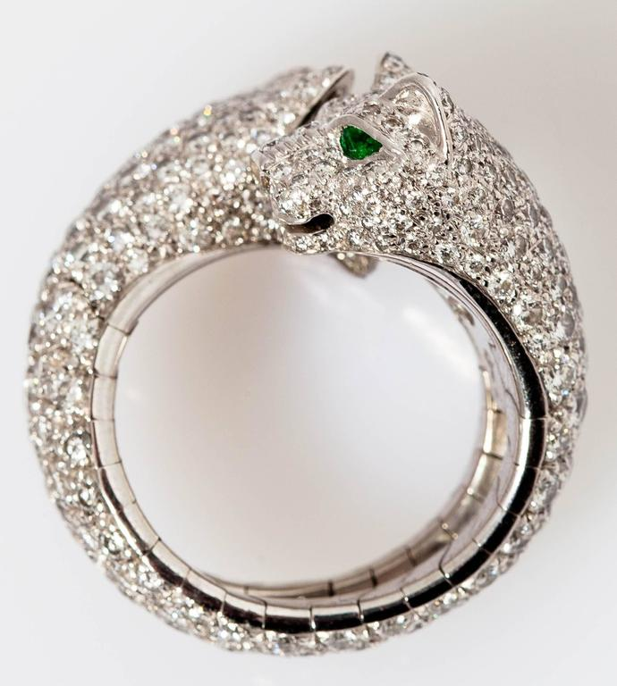 """Beautiful ring designed as a 18k white gold, accented by 4 emerald eyes and pave brilliant diamonds. Rare piece, part of Cartier's """"Panthere"""" collection."""