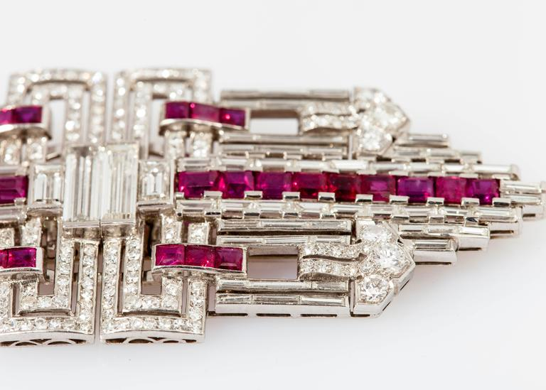 Beautiful Art Deco double clip finely crafted in platinum, with rubies weighing approx. 6.00 carats and brilliant-cut diamonds weighing 12.00 carats.