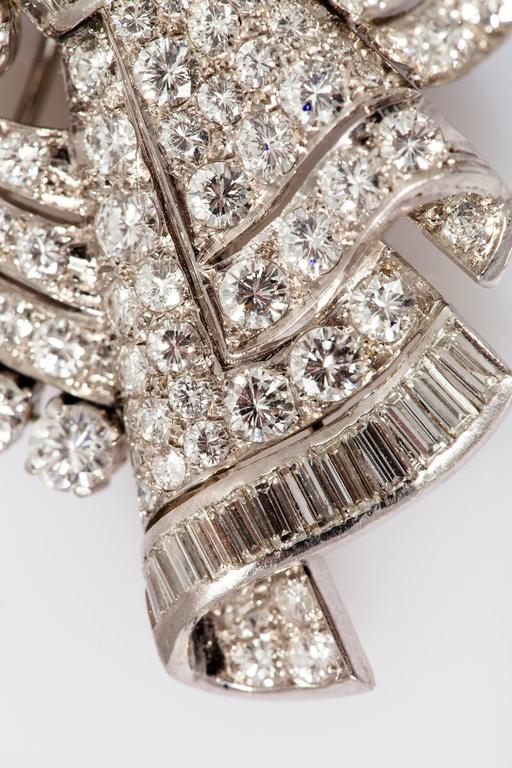 Gorgeous Art Deco double clip finely crafted in platinum with a mix of baguette and round cut diamonds weighing approx. 20.00 carats and two round brilliant cut diamonds weighing 1.00 carats.