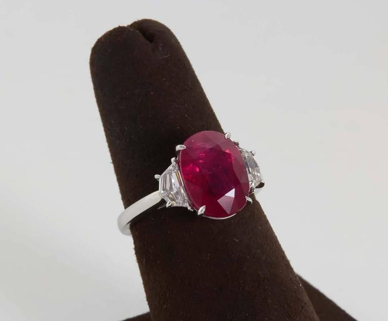 A bright and brilliant 5.33 carat oval GIA certified Ruby.  Set with .66 carats of side diamonds.  Hand crafted platinum mounting.  An impressive and wearable fine ruby ring.