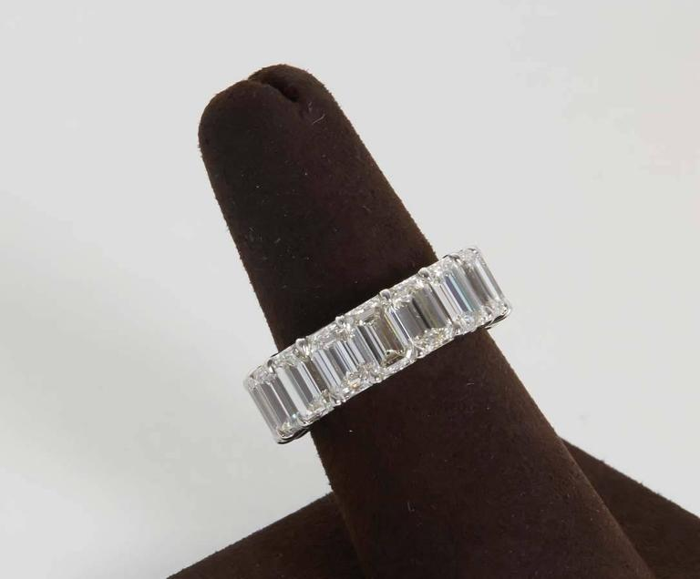 A magnificent diamond eternity band!  14.11 carats of Emerald cut diamonds G color VS clarity set in a custom platinum mounting.   The ring is currently a size 6.5 but can be adjusted.