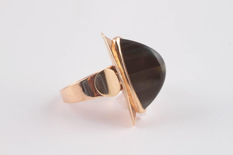 8 carat, yellow gold with green tiger's eye stone.  Size 8 1/4.  A great look for day or night