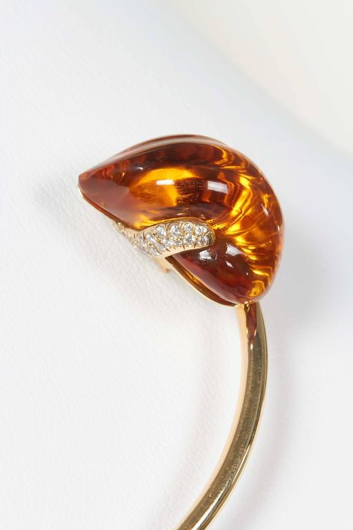 Delicate 15 ct hand-carved citrine bud set on an 18K yellow gold stem with approximately 0.2 ct of VS-FG white diamonds. As in all of Naomi's jewels, this citrine is a hand-carved, completely unique work of art with a carefully designed custom