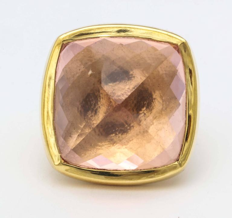 An 18kt yellow gold ring featuring a large faceted morganite which has been bezel set, and set upside down. size 6.75 Stone Height: .75 inch