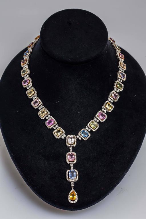 Beautiful multi-color sapphire necklace finely crafted in 18k white gold, with pink, light and dark yellow, blue, green sapphires weighing approx. 55.24 carats and round brilliant cut diamonds weighing approx.13.22 carats.