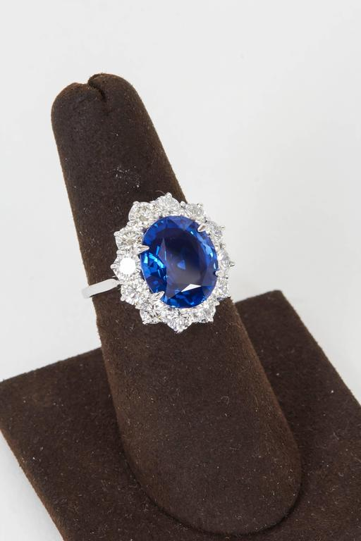 A beautiful sapphire set in an elegant and timeless ring.   6.02 carat oval fine blue sapphire, with exceptional color and brilliance, set in a platinum and diamond mounting featuring 2.88 carats of F color VS clarity round brilliant cut