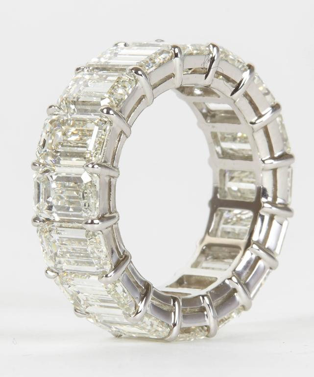Incredible Carat Size Emerald Cut Diamond Platinum Eternity Band Ring In New Condition In New York, NY