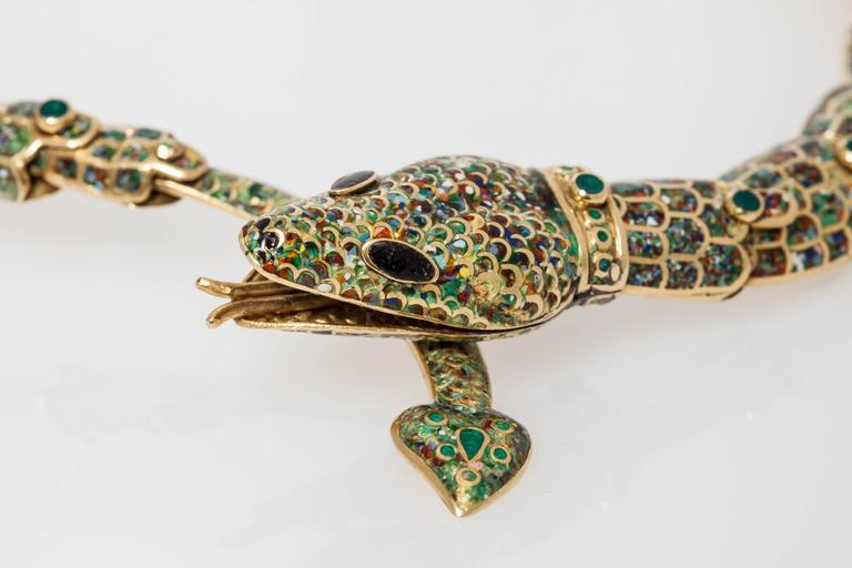 A peculiar snake set comprising a bracelet and a necklace, in 18kt yellow gold and fine enameling. Made in Taxco, Mexico, circa 1950.