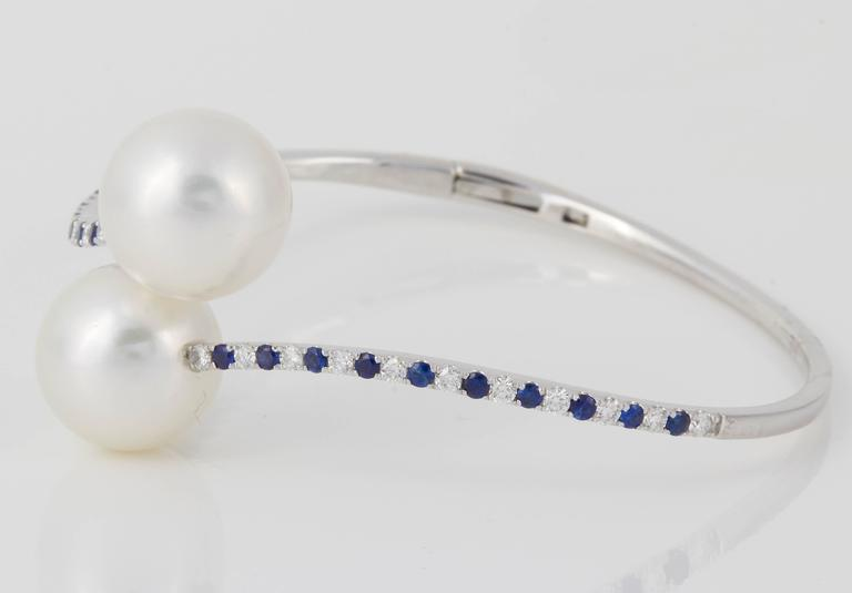 18K white Gold 8.5 g. South Sea Pearl;13 mm Sapp.: 0.55 cts. Diamond: 0.55 cts.