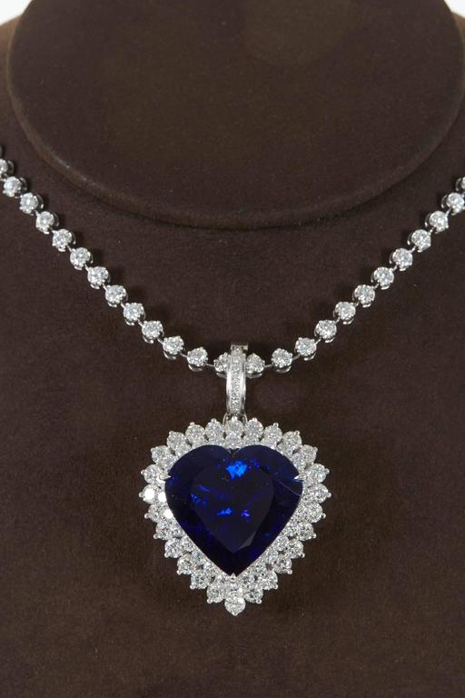 Rare 4927 carat heart shape tanzanite diamond pendant for sale at diamond pendant for sale a collectors piece 4927 brilliant heart shaped tanzanite full of life with blue and mozeypictures Images