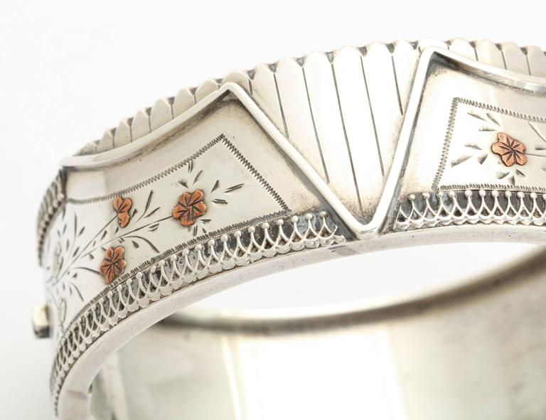 We admire he geometric detail of this Silver Victorian Cuff,  and the  wonderful engraving of gold washed spring flowers. The designs of Victorian silver are extremely varied. This bracelet hints at the risqué image of a partially undone corset.