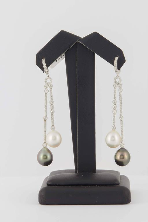 18KW  5.6 g. South Sea and Tahitian pearl 10-11 mm 114 Diamonds 1.07 Cts.