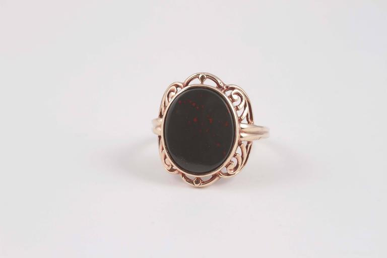 Lovely Arts and Crafts yellow gold and bloodstone ring. Size 7 1/4