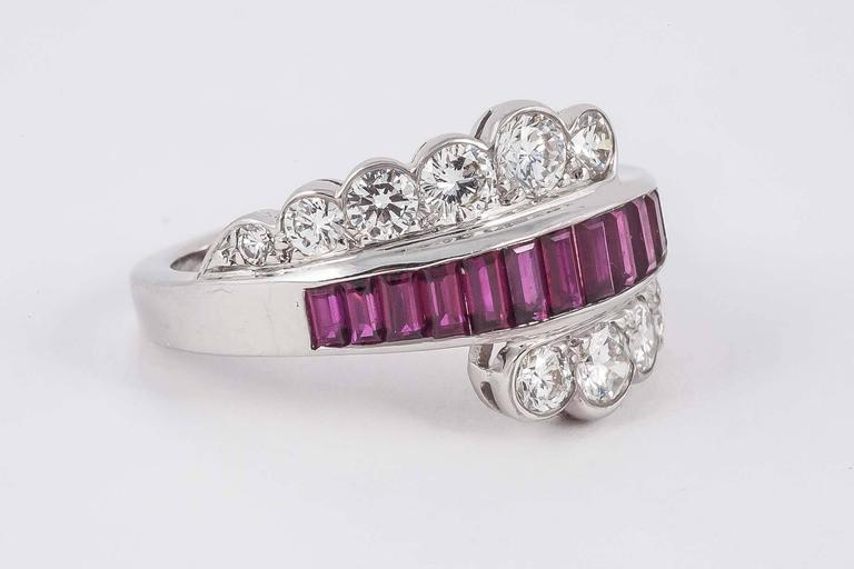 Stylish dress ring set with calibrated natural Burma Rubies and Diamonds. Set in 18ct white gold