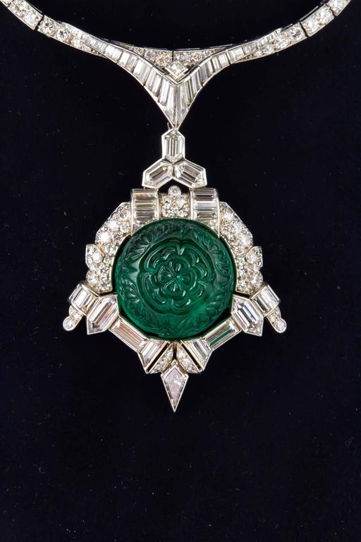 This is a beautiful and unique Antique Art Deco necklace  finely crafted in Platinum with diamonds and detachable diamond and emerald pendant . Carved emerald weighs approximately 35.00 carats and diamonds weighing a total of approximately 30.00