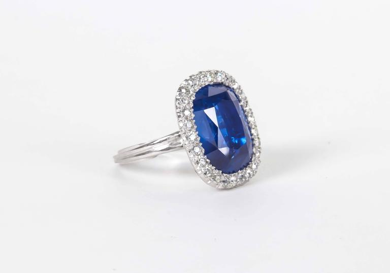 A collectors dream!!!  A rare GIA certified 15.02 carat Cushion cut Burma Blue Sapphire with ZERO TREATMENT. NO HEAT!  This fabulous Burma Blue Sapphire is set with approximately .50 carats of F color VS clarity round single cut diamonds. A