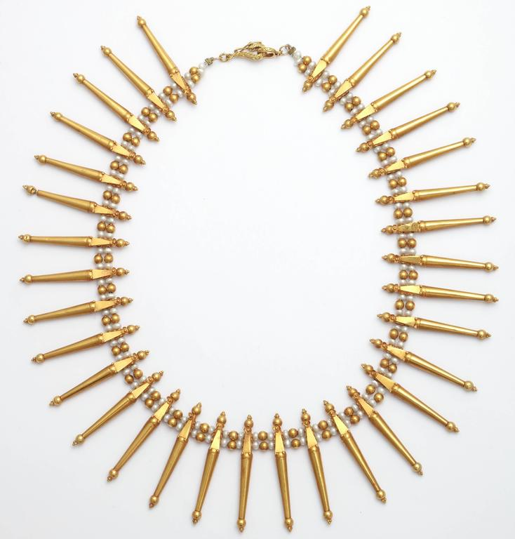 Classic and elegant Grecian style fringe necklace. The necklace has 32 'spike' components in 18 Kt gold separated by fresh water pearls and gold beads. Great for evening  wear with a toga dress or under a white shirt with your favorite jeans. The