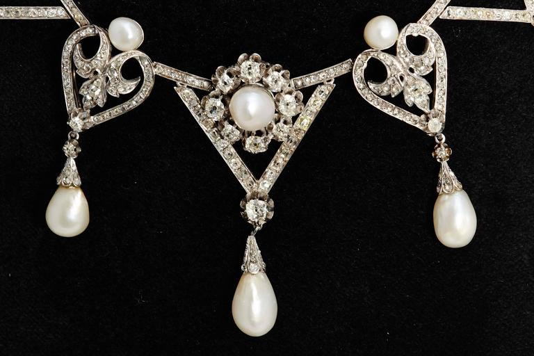 An important Bellè Epoque natural pearl and diamond necklace, mounted on  platinum, circa 1910.