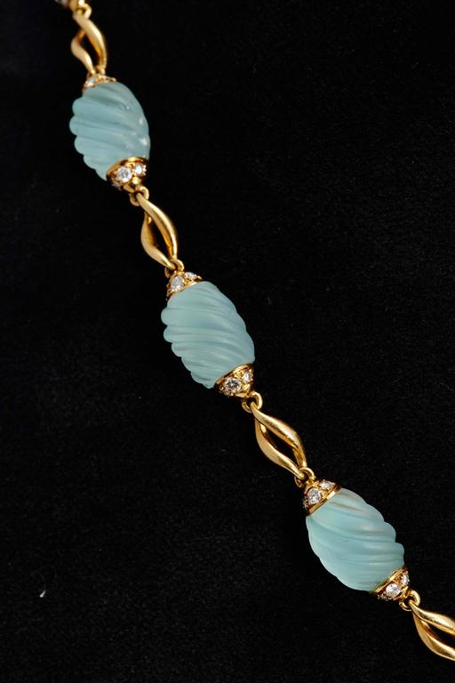 A sophisticated sautoir necklace with frosted aquamarine elements, interlinked by 18kt gold, highlighted with diamonds. The item is detachable to form a bracelet and a shorter necklace. French importation marks present, circa 1970.