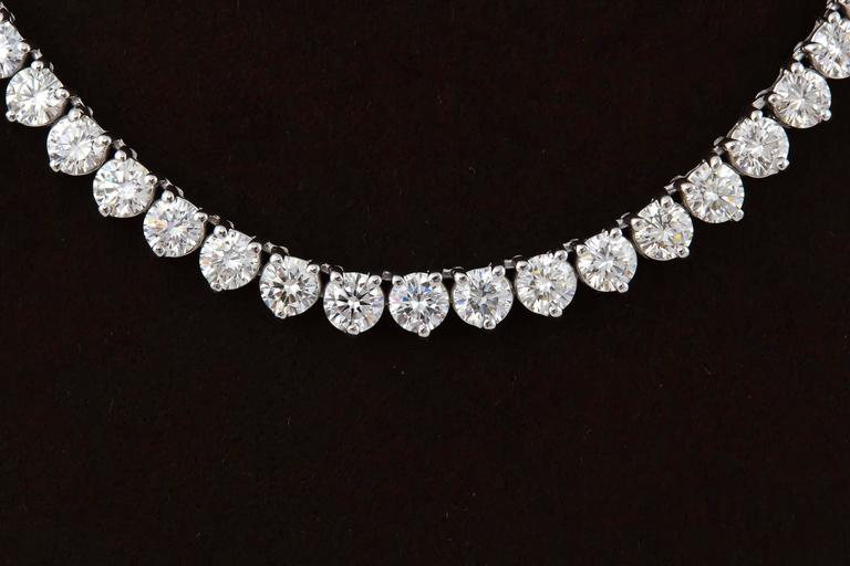 A high quality diamond tennis necklace.  24.88 carats of E/F color VS clarity round brilliant cut diamonds set in an 18k white gold three prong mounting.   approximately 17.25 inches  This necklace is full of life and brilliance!  A