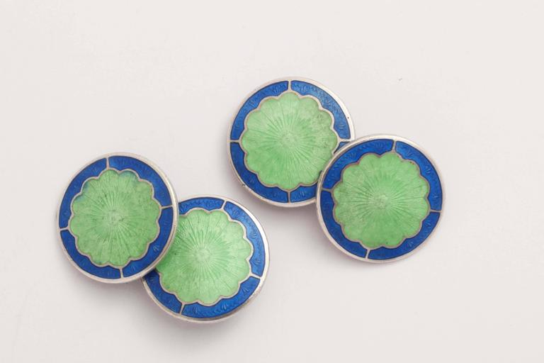 Circular with scalloped green center surrounded by blue border. Impressed STERLING/ B back to back with an R.