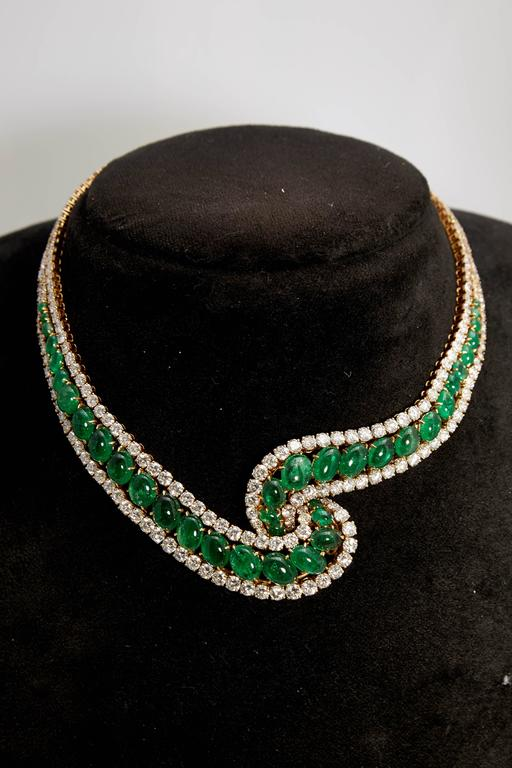 An impressive Colombian cabochon emerald (45 carats) and diamond (38cts) necklace or undulated design. Made in Italy, circa 1960.