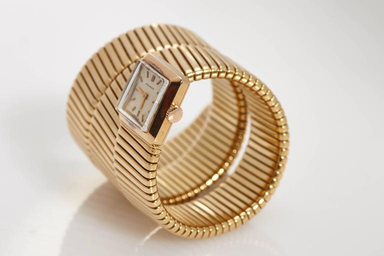 An unusually large version of the everlasting Bulgari Tubogas lady's watch-bracelet, carrying a Movado movement. Mounted in 18kt yellow gold. Made in Italy, circa 1965.